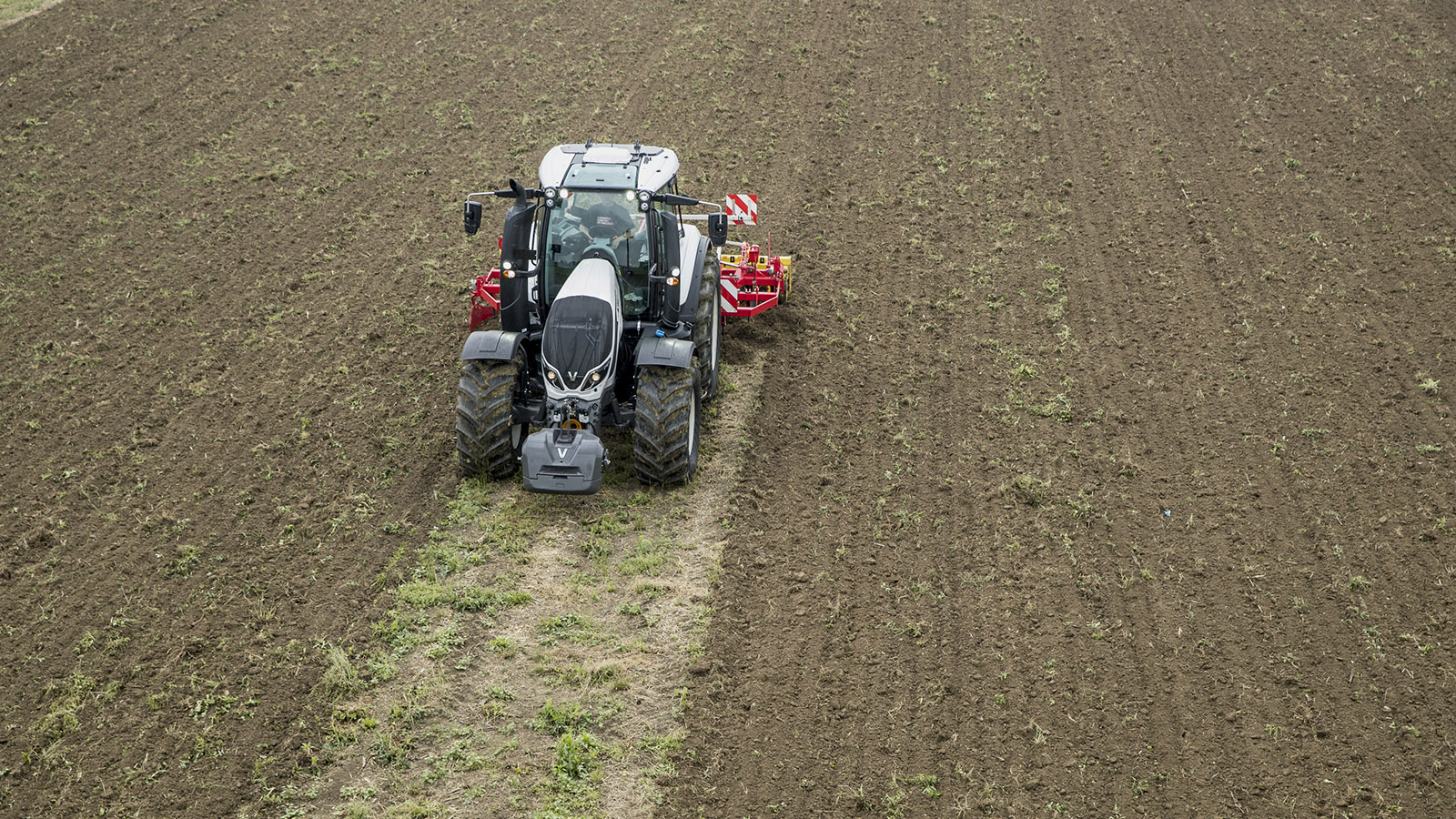 valtra t series tractor farm machinery on the field working